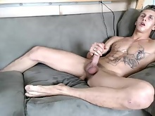 Webcam whore cums w/buttplug in his ass. big feet and hung 4
